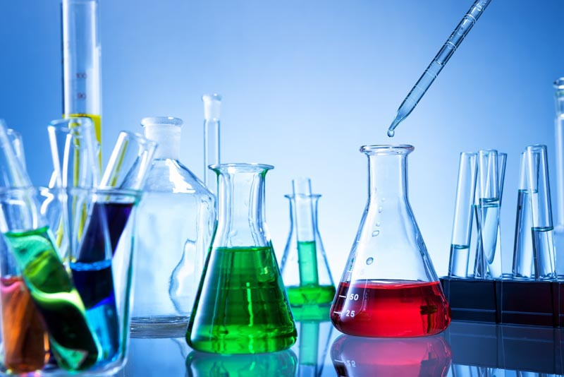 Laboratory equipment, lots of glass filled with colorful liquids